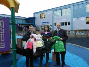 John Binkley, President of the Alaska Cruise Association/CLIA Alaska (left) , presents Juneau School District Chief of Staff Kristin Bartlett and Board of Education President Brian Holst with 400 warm coats for Juneau students.
