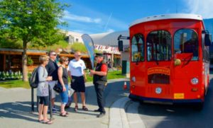 Visitors stand in front of Anchorage Trolley