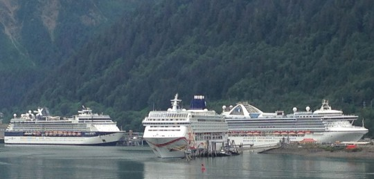 Three cruise ships dock in downtown Juneau July 14, at the height of the tourist season. (Photo by Ed Schoenfeld/CoastAlaska News)