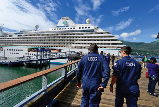 Members of Coast Guard Sector Juneau Inspections Division arrive at the cruise ship Crystal Serenity