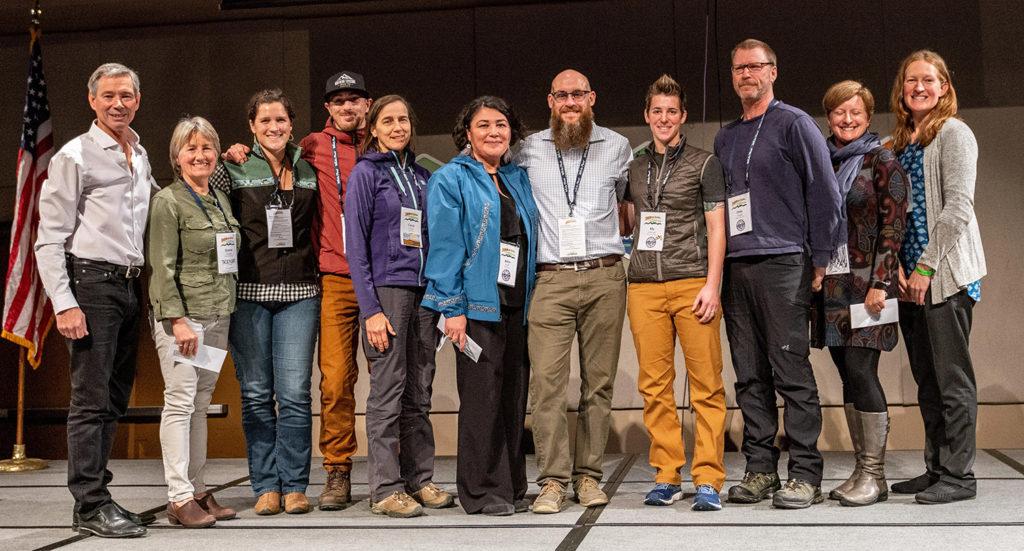 Former CLIA Alaska President John Binkley presents this year's scholarship winners. Courtesy ATIA/Frank Flavin